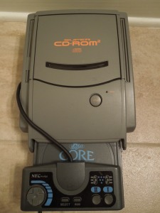 There were different versions of PC Engine CD-ROM players; this one attaches to an original PC Engine Hu-card player.