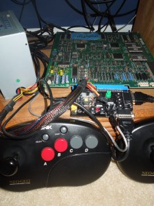 WWF WrestleFest arcade board, ATX power supply, supergun, and Neo Geo controllers.