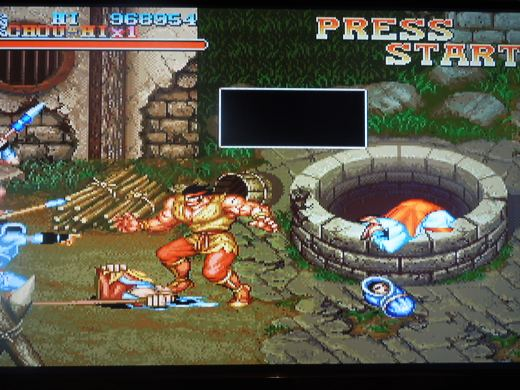 This controversial scene where a woman abandons her baby before throwing herself down a well was removed from the international arcade version of Warriors of Fate.
