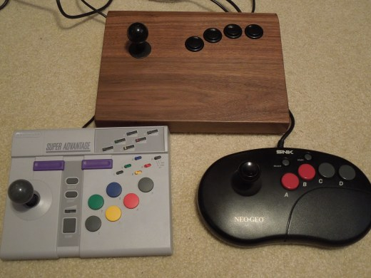The Walnut Arcade Stick dwarves (somewhat) the Neo Geo Pro Controller and the SNES Advantage.